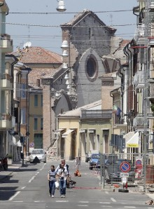 A view of a semi-collapsed church in Mirandola, northern Italy, is seen as people leave home, Tuesday, May 29, 2012. A magnitude 5.8 earthquake struck the same area of northern Italy stricken by another fatal tremor on May 20.  (AP Photo/Luca Bruno)